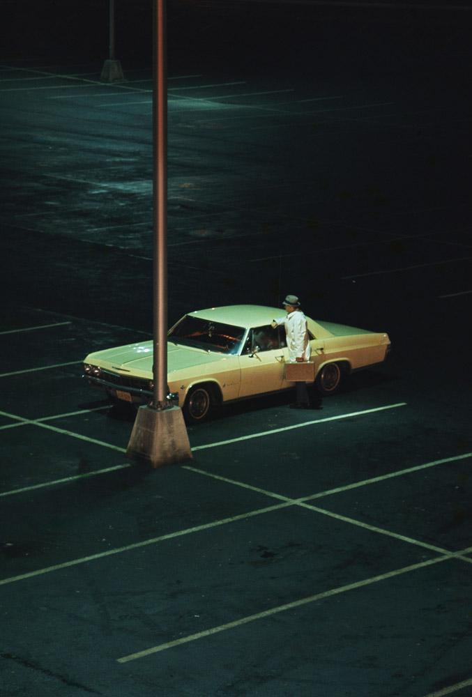 Parking lot at night - lone car